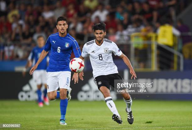 Mahmoud Dahoud of Germany and Lorenzo Pellegrini of Italy during their UEFA European Under21 Championship 2017 match on June 24 2017 in Krakow Poland