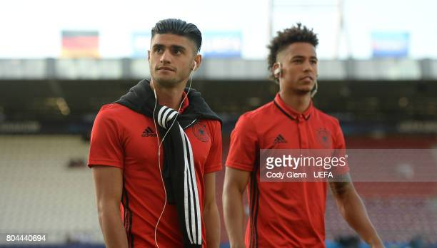 Mahmoud Dahoud of Germany and teammate Thilo Kehrer walk the pitch before their UEFA European Under21 Championship 2017 final match against Spain on...