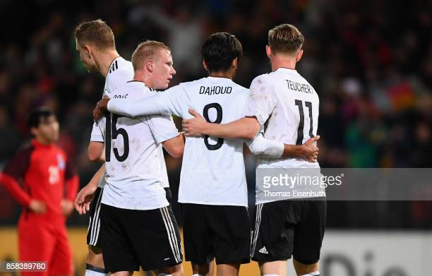 Mahmoud Dahoud of Germany celebrates with Philipp Ochs and Cedric Teuchert during the UEFA Under21 Euro 2019 Qualifier match between U21 of Germany...