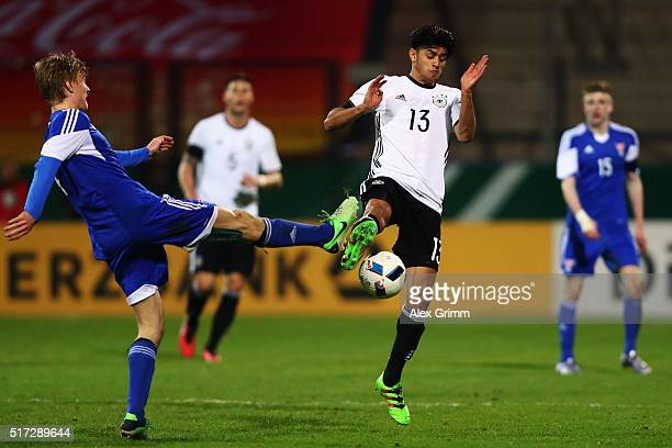Mahmoud Dahoud of Germany is challenged by Andrias Eriksen of Faroe Islands during the 2017 UEFA European U21 Championships qualifier match between...