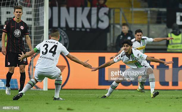 Mahmoud Dahoud of Gladbach celebrates with his teammates after scoring his team's second goal during the Bundesliga match between Eintracht Frankfurt...