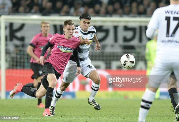 Mahmoud Dahoud of Moenchengladbach and Julius Kade of Berlin battle for the ball during the Bundesliga match between Borussia Moenchengladbach and...