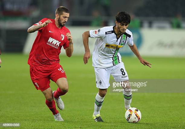 Mahmoud Dahoud of Moenchengladbach and Sascha Moelders of Augsburg fight for the ball during the Bundesliga match between Borussia Moenchengladbach...