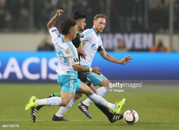 Mahmoud Dahoud of Moenchengladbach and Thilo Kehrer of Schalke and Benedikt Hoewedes battle for the ball during the UEFA Europa League Round of 16...