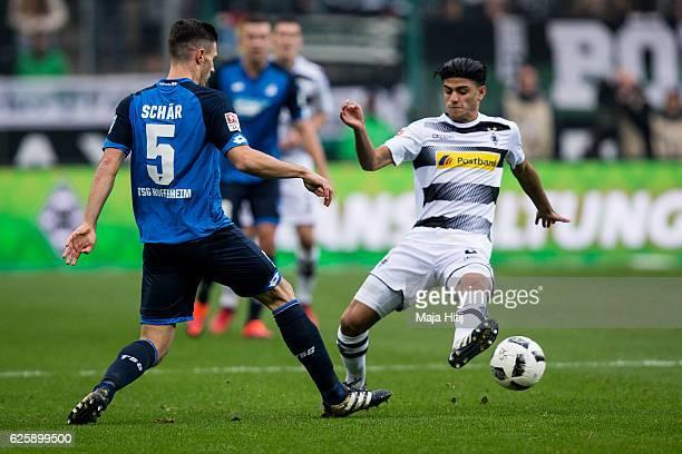 Mahmoud Dahoud of Moenchengladbach battles for the ball with Fabian Schaer of Hoffenheim during the Bundesliga match between Borussia...