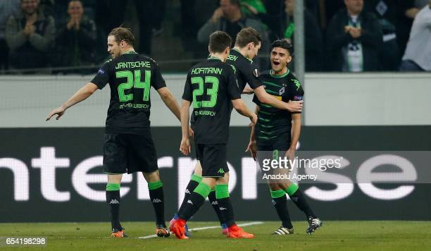 Mahmoud Dahoud of Moenchengladbach celebrates scoring a goal with his teammates during the UEFA Europa League round of 16 soccer match between...
