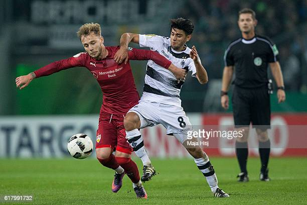 Mahmoud Dahoud of Moenchengladbach is challenged by Alexandru Maxim of Stuttgart during the DFB Cup match between Borussia Moenchengladbach and VfB...