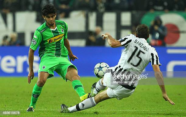 Mahmoud Dahoud of VfL Borussia Monchengladbach competes for the ball with Andrea Barzagli of Juventus FC during the UEFA Champions League group stage...