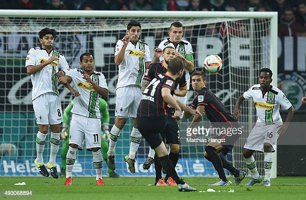 Mahmoud Dahoud Raffael Lars Stindl and Granit Xhaka of Gladbach block a free kick of Marc Stendera of Frankfurt during the Bundesliga match between...
