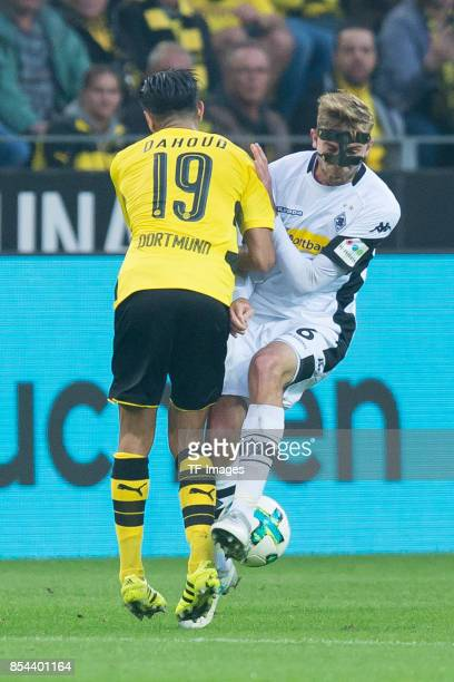 Mahmound Dahoud of Dortmund and Christoph Kramer of Moenchengladbach battle for the ball during the Bundesliga match between Borussia Dortmund and...
