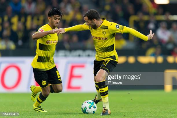 Mahmound Dahoud of Dortmund and Gonzalo Castro of Dortmund battle for the ball during the Bundesliga match between Borussia Dortmund and 1 FC Koeln...