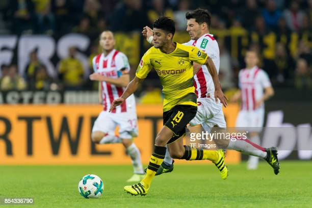 Mahmound Dahoud of Dortmund and Milos Jojic of Koeln battle for the ball during the Bundesliga match between Borussia Dortmund and 1 FC Koeln at the...