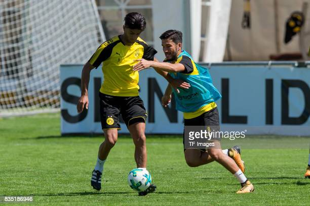 Mahmound Dahoud of Dortmund and Nuri Sahin of Dortmund battle for the ball during a training session as part of the training camp on July 30 2017 in...