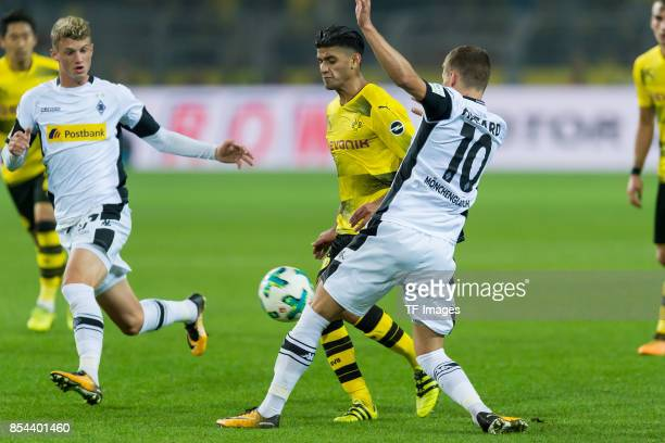 Mahmound Dahoud of Dortmund and Thorgan Hazard of Moenchengladbach battle for the ball during the Bundesliga match between Borussia Dortmund and...