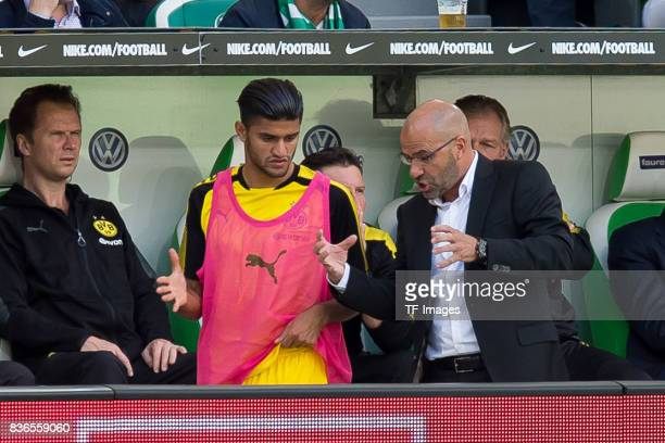 Mahmound Dahoud of Dortmund speak with Head coach Peter Bosz of Dortmund during to the Bundesliga match between VfL Wolfsburg and Borussia Dortmund...