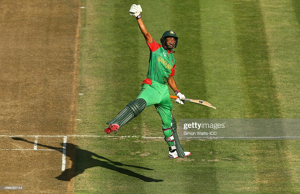 MD Mahmudullah of Bangladesh celebrates scoring a century during the 2015 ICC Cricket World Cup match between Bangladesh and New Zealand at Seddon Park on March 13, 2015 in Hamilton, New Zealand.