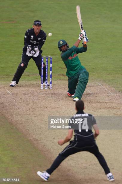 Mahmudullah of Bangladesh hits a straight four off the bowling of Mitchell Santner of New Zealand during the ICC Champions Trophy match between New...