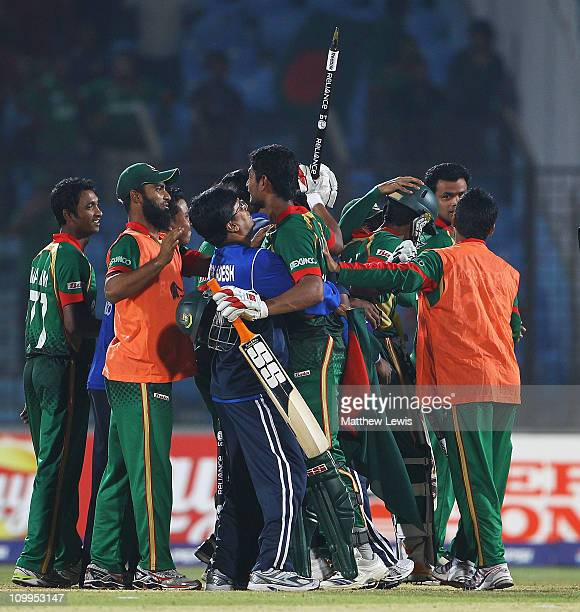 Mahmudullah of Bangladesh is congratulated by his team mates after hitting the winning runs during the 2011 ICC World Cup Group B match between...