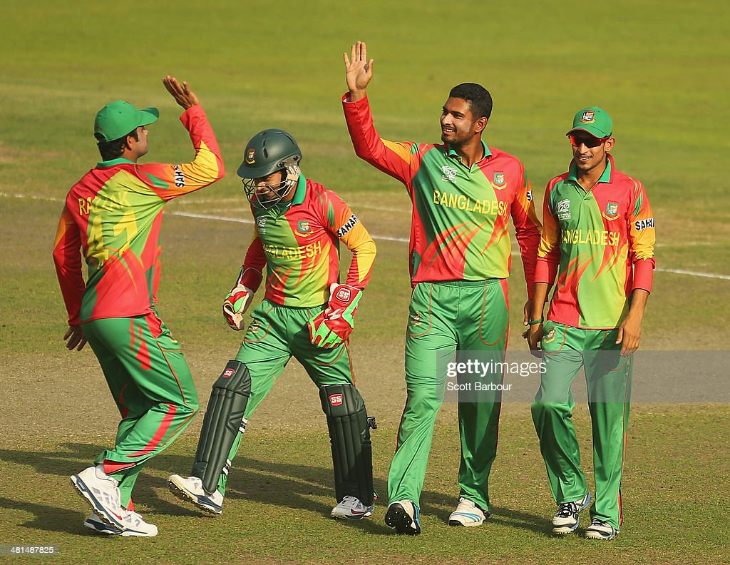 Mahmudullah of Bangladesh is congratulated by his teammates after dismissing Umar Akmal of Pakistan during the ICC World Twenty20 Bangladesh 2014 match between Pakistan and Bangladesh at Sher-e-Bangla Mirpur Stadium on March 30, 2014 in Dhaka, Bangladesh.