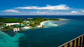 Beautiful resort on the tropical island viewed from the cruise ships open deck. Beach is located in Roatan Island, Honduras. Close to the beach is a natural coral reef. It is great for relaxation and