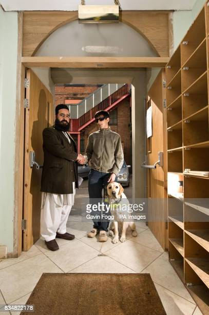 MahomedAbraar Khatri 18 and Vargo the first guide dog in the UK to enter a mosque are welcomed into the Bilal Jamia mosque in Leicester by Head Imam...