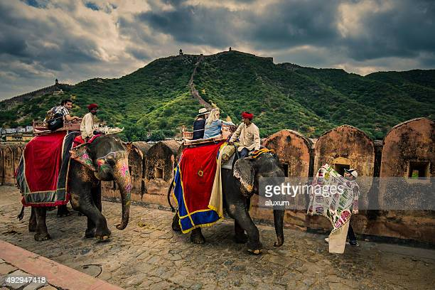 Mahouts and tourists with elephants in Amber Fort Jaipur India