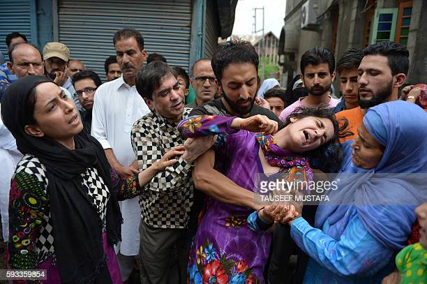 TOPSHOT Mahvish the sister of Kashmiri Irfan Ahmed who was killed by a teargas shell breaks down as local residents visit the family to offer their...