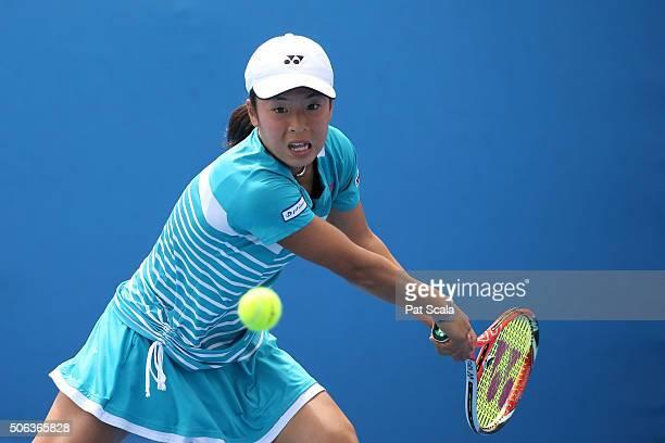 Mai Hontama of Japan plays a backhand in her first round juniors match against Lara Salden of Belgium during the Australian Open 2016 Junior...