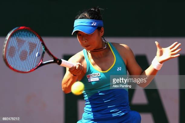 Mai Hontama of Japan plays a forehand during girls singles first round match against Francesca Jones of Great Britain on day nine of the 2017 French...