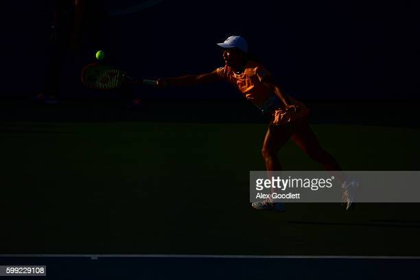 Mai Hontama of Japan returns a shot to Sofia Kenin of the United States during her first round Junior Girl's match on Day Seven of the 2016 US Open...