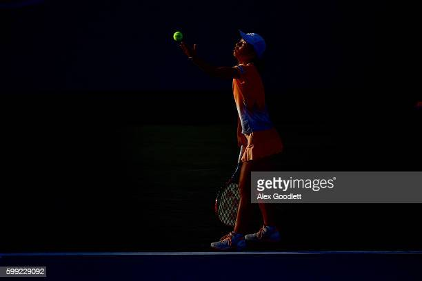 Mai Hontama of Japan serves to Sofia Kenin of the United States during her first round Junior Girl's match on Day Seven of the 2016 US Open at the...
