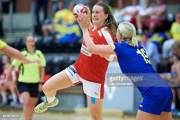 Mai Kragballe of Denmark challenge for the ball during the Scandinavian Open match between Denmark U20 and Sweden U20 at Vejen Idratscenter on June...