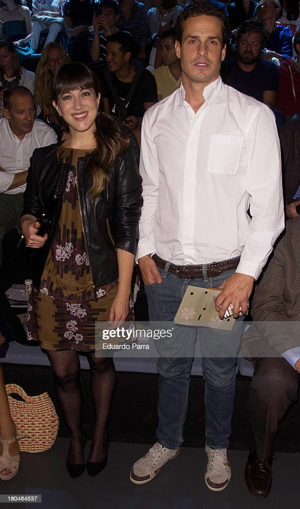 Mai Meneses (L) and Kim Fanlo from spanish pop band Nena Daconte attend a fashion show during the Mercedes Benz Fashion Week Madrid Spring/Summer 2014 on September 13, 2013 in Madrid, Spain.
