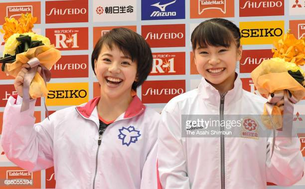Mai Murakami and Aiko Sugihara pose for photographs after they are selected as members of the World Artistic Gymnastic Championships during day two...