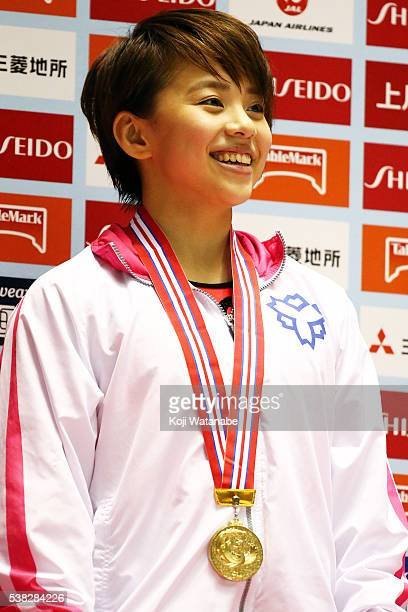 Mai Murakami celebrates at the award ceremony for the floor during the AllJapan Gymnastic Appratus Championshipsat Yoyogi National Gymnasium on June...