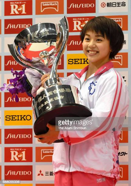 Mai Murakami celebrates with the trophy after winning the Women's AllAround during day two of the Artistic Gymnastics NHK Trophy at the Tokyo...