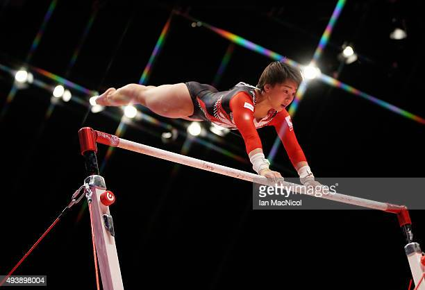 Mai Murakami of Japan goes through her routine on the Uneven Bars during Day One of the 2015 World Artistic Gymnastics Championships at The SSE Hydro...