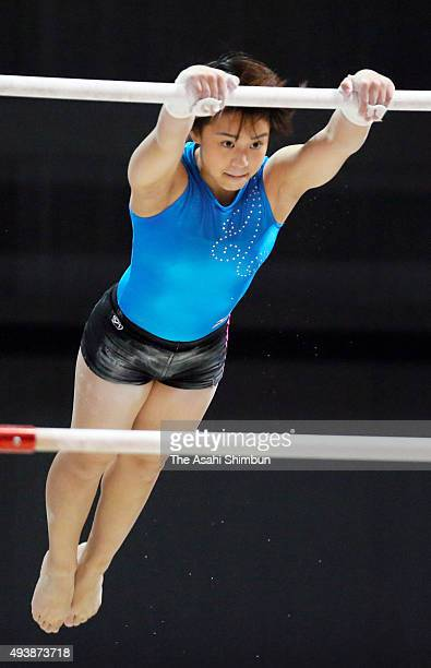 Mai Murakami of Japan performs in Uneven Bars during a practice session ahead of the World Artistic Gymnastics Champipnships at the SSE Hydro on...