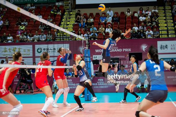 Mai Okumura of Japan jumps to strike the ball during a game against Russia at the Women's Volleyball World Grand Prix in Hong Kong on July 23 2017 /...