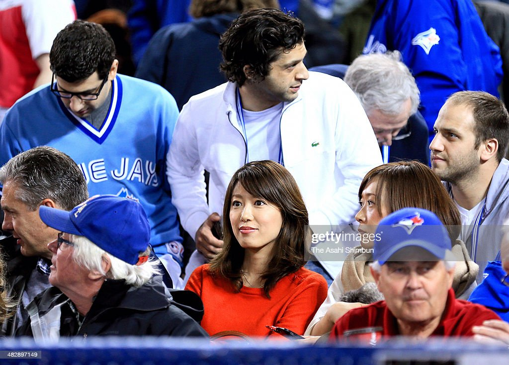Mai Satoda, watches her husband Masahiro Tanaka #19 of the New York Yankees making debut during the MLB game against the Toronto Blue Jays on April 4, 2014 at Rogers Centre in Toronto, Ontario, Canada.