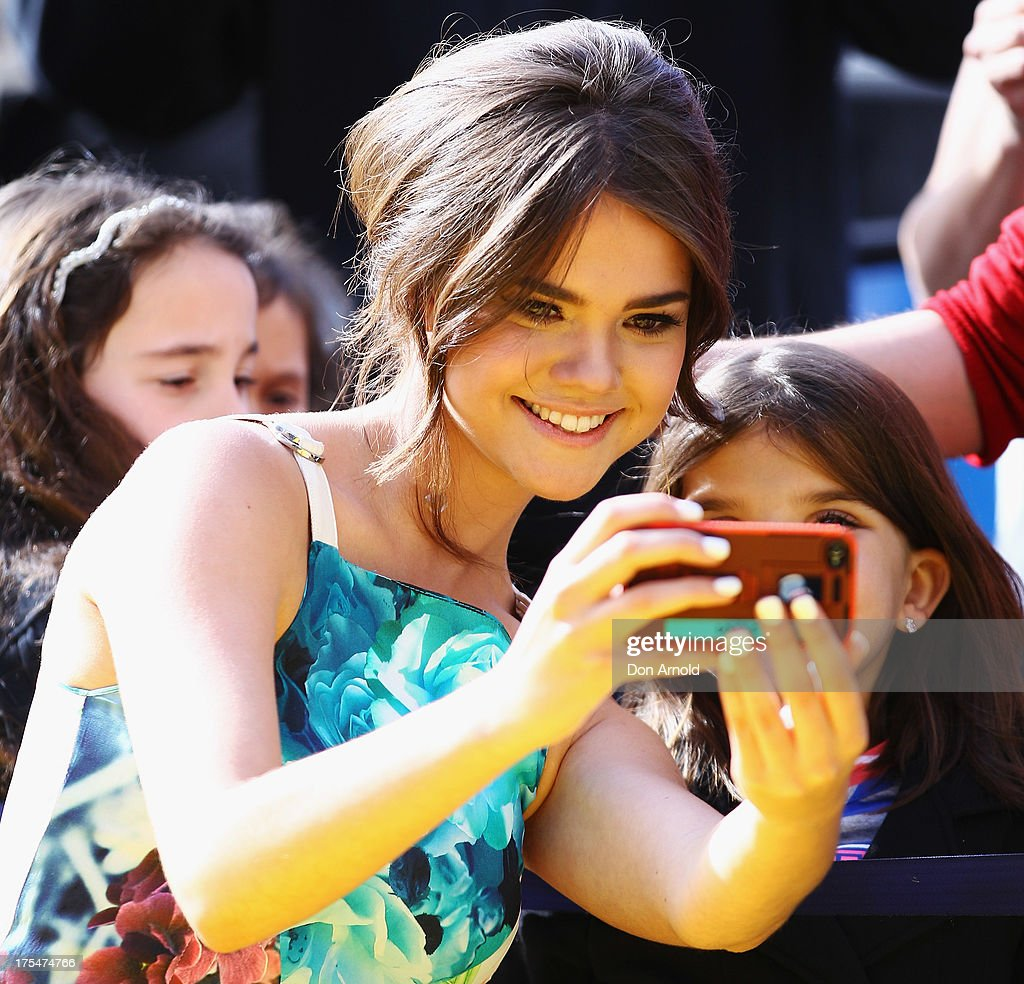 <a gi-track='captionPersonalityLinkClicked' href=/galleries/search?phrase=Maia+Mitchell&family=editorial&specificpeople=9453855 ng-click='$event.stopPropagation()'>Maia Mitchell</a> greets fans during the Australian premiere of The Disney Channel's 'Teen Beach Movie' on August 4, 2013 in Sydney, Australia.