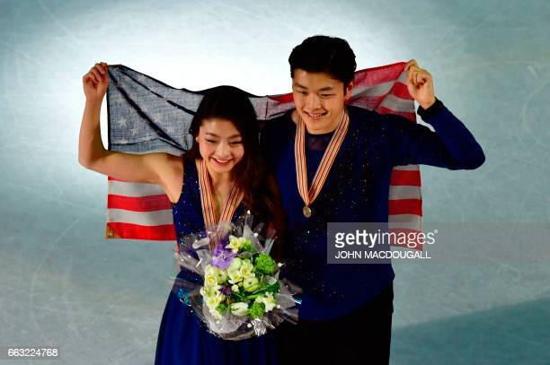 Maia Shibutani and Alex Shibutani of the US pose with their national flag after placing third in the Ice Dance / Free Dance event at the ISU World...
