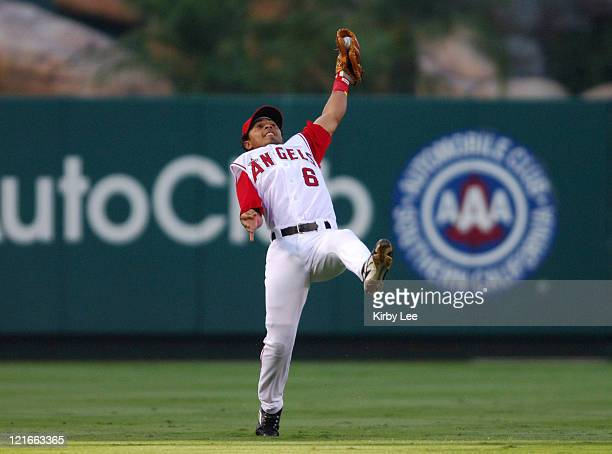 Maicer Izturis makes an offbalance catch of a fly ball by Randy Winn of the Seattle Mariners in the first inning of 63 loss at Angel Stadium in...