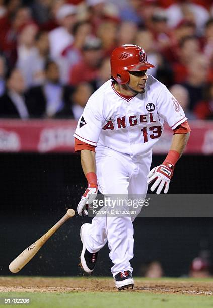 Maicer Izturis of the Los Angeles Angels of Anaheim hits an RBI single in the seventh inning against the Boston Red Sox in Game Two of the ALDS...