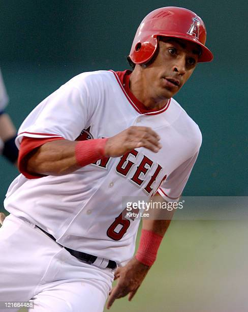 Maicer Izturis of the Los Angeles Angels of Anaheim rounds third base to score in the first inning of 105 victory over the Cleveland Indians at Angel...