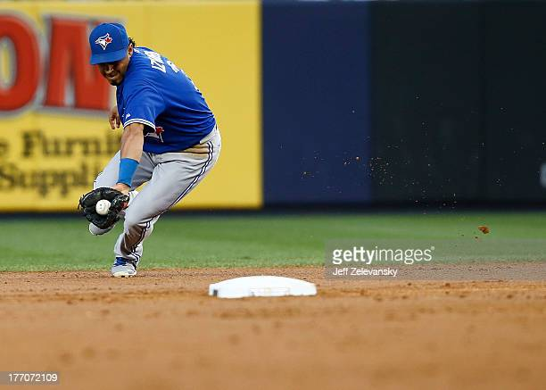 Maicer Izturis of the Toronto Blue Jays fields a ground ball hit by Brett Gardner of the New York Yankees during the second game of a double header...