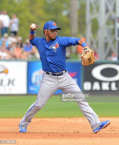 Maicer Izturis of the Toronto Blue Jays fields during a spring training game against the Detroit Tigers at Joker Marchant Stadium on March 11 2014 in...