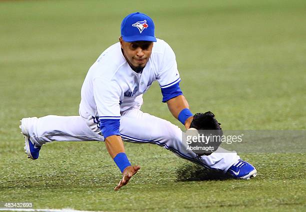 Maicer Izturis of the Toronto Blue Jays grabs a grounder to end the 4th inning against the Houston Astros during MLB action at the Rogers Centre...