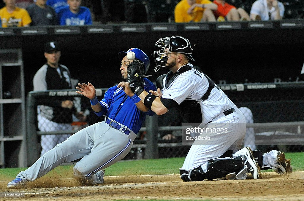 Maicer Izturis #3 of the Toronto Blue Jays is safe at home as Tyler Flowers #21 of the Chicago White Sox drops the ball during the tenth inning on June 11, 2013 at U.S. Cellular Field in Chicago, Illinois. The Toronto Blue Jays defeated the Chicago White Sox 7-5 in ten innings.