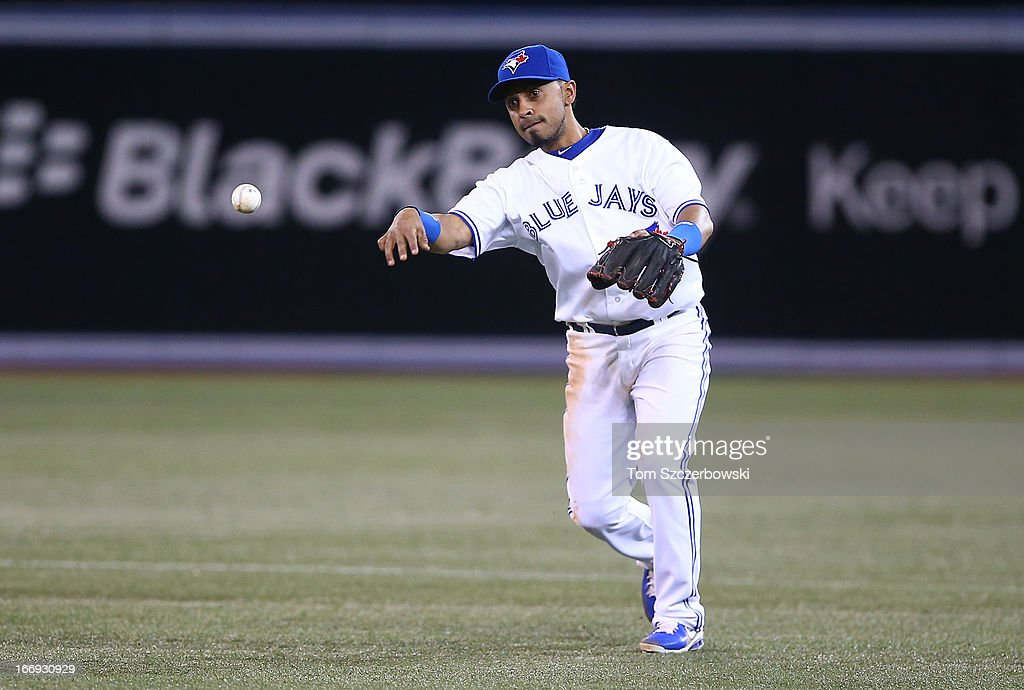 Maicer Izturis #3 of the Toronto Blue Jays throws out the baserunner in the ninth inning during MLB game action against the Chicago White Sox on April 18, 2013 at Rogers Centre in Toronto, Ontario, Canada.